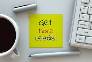 Get More Leads, message on note paper, computer and coffee on table